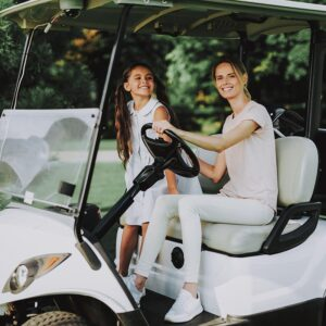 mother and daughter riding 4 person golf cart